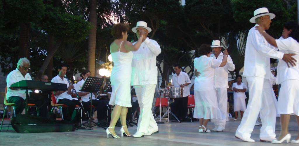 Danzonera Alma de Veracruz playing danzón, with members of Grupo Oficial dancing in the Port of Veracruz, Mexico
